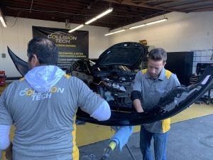 black car being worked on in a garage