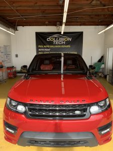 clean buffed red car range rover